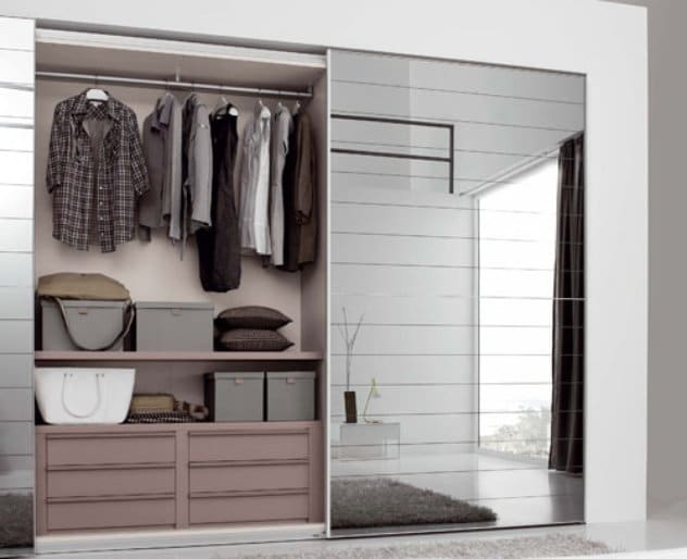 Sliding doors take up a lot less room that standard wardrobe doors that open outwards