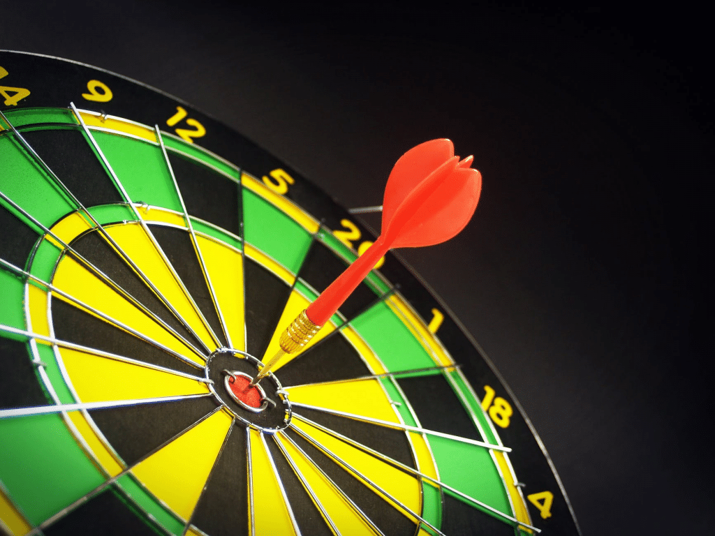 Darts board with arrow in bullseye