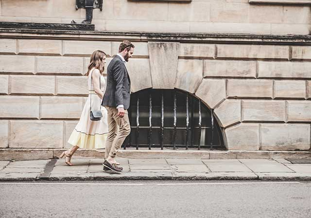 Couple walking down street together