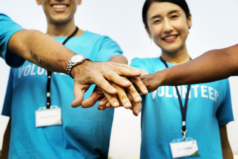volunteers helping hands