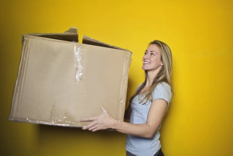 Woman holding storage box