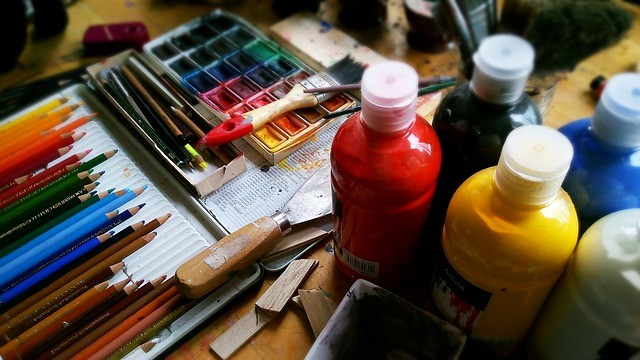 Artists paint bottle and brushes